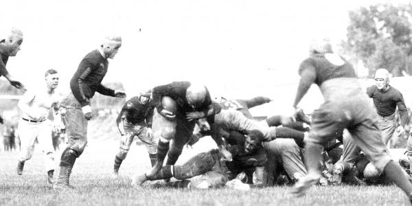 Duke Slater playing football