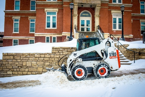 Bobcat snow removal outside Calvin